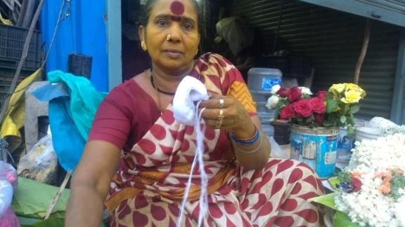 Rukmani P., 54, says she can't afford to continue to run a pump that extracts water from a well.