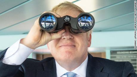 Boris Johnson looks through binoculars on the bridge of the Isle of Wight ferry as it sets sail on June 27, 2019 in Portsmouth, England.