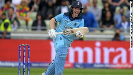 England's captain Eoin Morgan hits the winning runs as he celebrates victory against Australia.