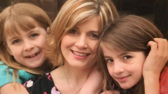 Abby, left, at age nine with her mom and sister.