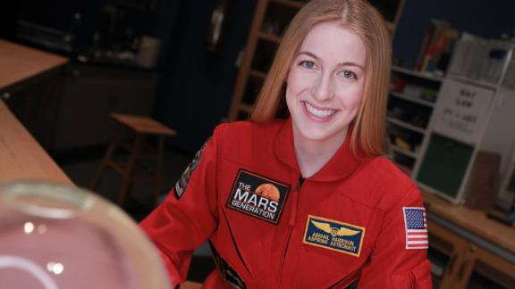 Abby sporting her signature red flight suit.