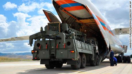 Parts of the S-400 air defense systems are unloaded from a Russian transport aircraft at Murted military airport in Ankara on Friday.