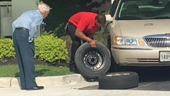 """It took Chick-fil-A manager Daryl Howard, right, about 15 minutes to change a flat tire for a 96-year-old WWII veteran employees know as """"Mr. Lee."""""""