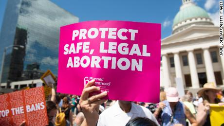 Protesters hold signs as they rally in support of Planned Parenthood and pro-choice and to protest a state decision that would effectively halt abortions by revoking the center's license to perform the procedure, near the Old Courthouse in St. Louis, Missouri, May 30, 2019. (Photo by SAUL LOEB / AFP)        (Photo credit should read SAUL LOEB/AFP/Getty Images)