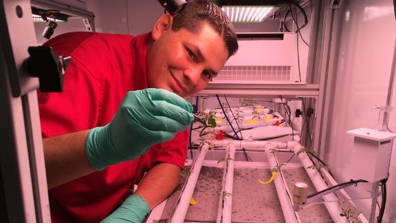 Jacob Torres with a microgravity test bed.