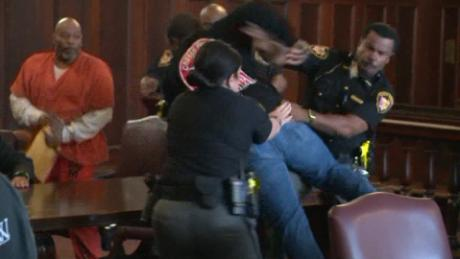 Sons attack mother's convicted killer in courtroom brawl