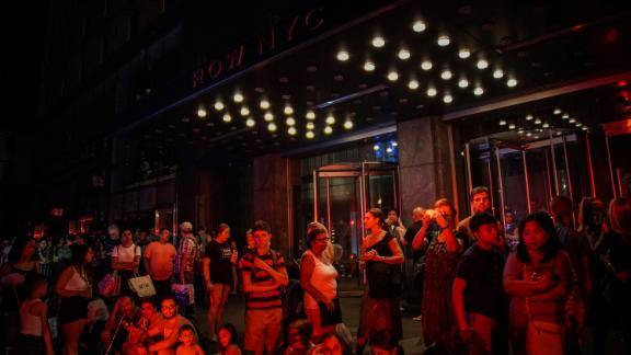 People are evacuated outside Row NYC hotel.