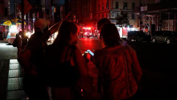 Pedestrians looks at their cellphones in midtown Manhattan.