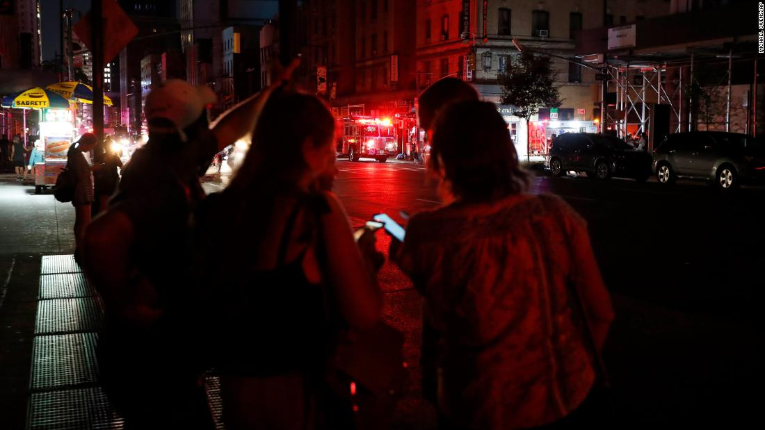 Pedestrians looks at their cellphones in midtown Manhattan.