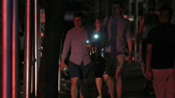 People use their phones as flashlights.