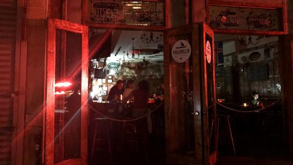 People sit inside a bar during the power outage.