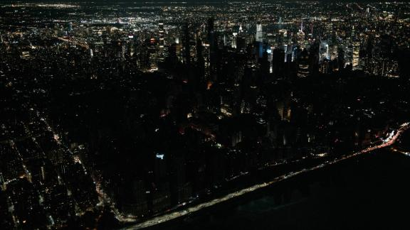 Seen from the air, a large section of Manhattan's Upper West Side and Midtown neighborhoods stand coated in darkness on Saturday, July 13.