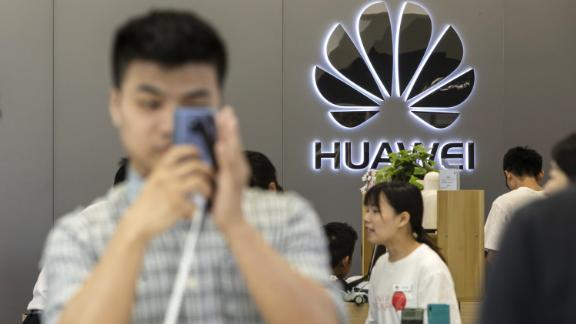 The Huawei Technologies Co. logo is displayed at a Huawei store in Shenzhen, China, on Wednesday, May 22, 2019. Huaweiis seeking about $1 billion from a small group of lenders, its first major funding test after getting hit with U.S. curbs that threaten to cut off access to critical suppliers. Photographer: Qilai Shen/Bloomberg via Getty Images