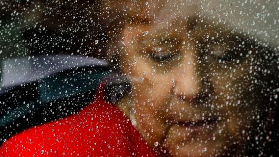 Rain drops cover the window of a car as Merkel arrives for the opening of the James-Simon-Galerie in Berlin, in July 2019. The James-Simon-Galerie is the new central entrance building for Berlin's historic Museums Island.