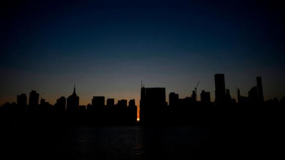 The sun sets behind 42nd Street in Manhattan during the power outage.