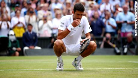 LONDON, ENGLAND - JULY 14:  Novak Djokovic of Serbia celebrates winning the Men's Singles final against Roger Federer of Switzerland during Day thirteen of The Championships - Wimbledon 2019 at All England Lawn Tennis and Croquet Club on July 14, 2019 in London, England. (Photo by Clive Brunskill/Getty Images)