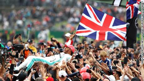 Lewis Hamilton crowd surfed with his adoring fans following his win at Silverstone.