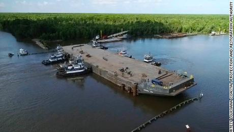 A sunken barge in Louisiana's Bayou Chene may have prevented major flooding by diverting waters from the Mississippi and Atchafalaya rivers.