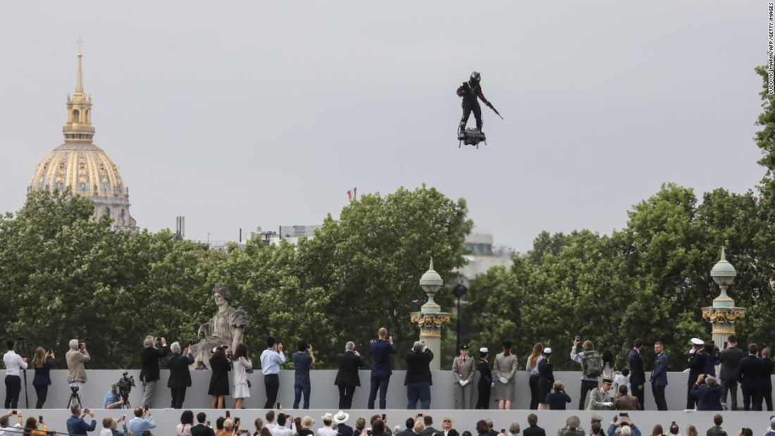 Man soars over Bastille Day celebrations on flying board