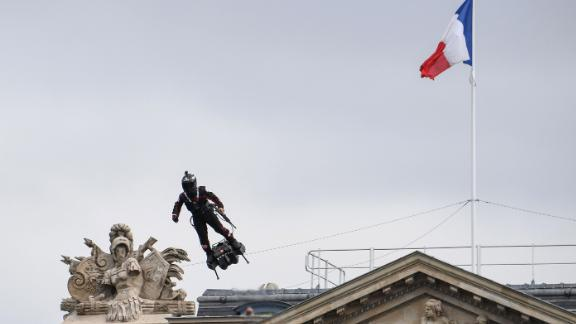 """Zapata CEO Franky Zapata flies his jet-powered """"Flyboard"""" over Bastille Day celebrations."""