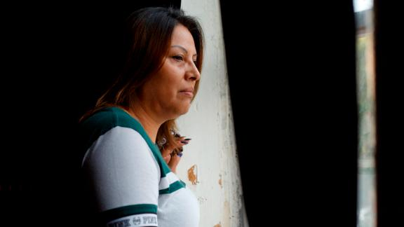 Francisca Lino poses for a portrait by the window she often looks out of onto the street outside Adalberto United Methodist Church in Chicago, Ill. on July 13, 2019. Lino, who is from Mexico, lives in a sanctuary living space above the church and has not left in two years for fear of deportation. The Trump administration has Immigration and Customs Enforcement (ICE) raids planned for Sunday.