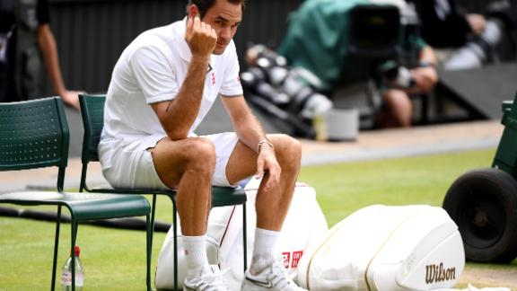 Roger Federer sits in his chair after losing a heartbreaker to Novak Djokovic in the men