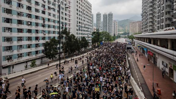 Demonstrators march during a protest in the Sha Tin district of Hong Kong on July 14, 2019.