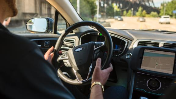 A driver looks from an Uber self-driving car on September 13, 2016 in Pittsburgh, Pennsylvania. Uber launched a groundbreaking driverless car service, stealing ahead of Detroit auto giants and Silicon Valley rivals with technology that could revolutionize transportation.  / AFP / Angelo Merendino        (Photo credit should read ANGELO MERENDINO/AFP/Getty Images)