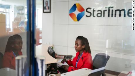 A receptionist sits at her desk in the lobby of StarTimes headquarters in Nairobi.