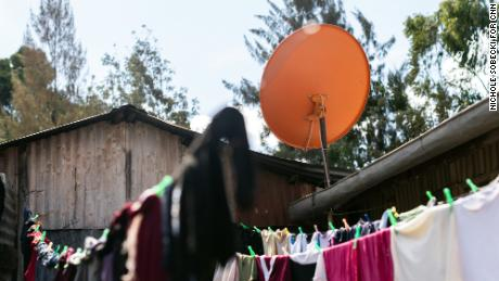 An orange StarTimes satellite sits atop a home in the Ndumbuini village.