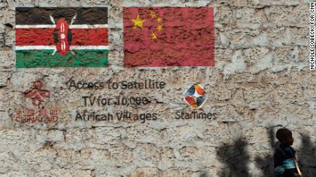 A StarTimes advertisement is painted across the side of a building in Ndumbuini village on the outskirts of Kenya's capital Nairobi, on April 5, 2019.