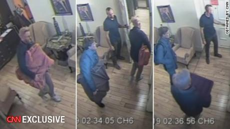 Associates of Julian Assange remove boxes covered by blankets from the embassy in the early hours of October 19, 2016. They also removed about 100 hard drives from the embassy, according to surveillance reports obtained by CNN.