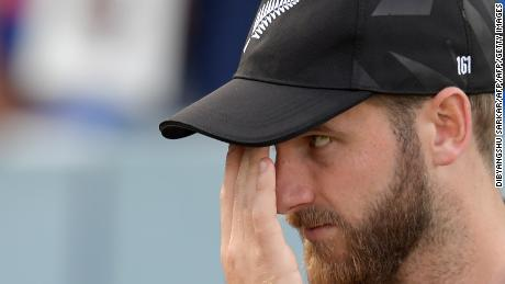 New Zealand's captain Kane Williamson looks on at the trophy presentation after defeat.