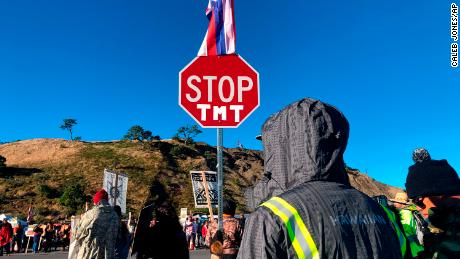 Hundreds of original Hawaiians gather to protest the construction of a telescope on a sacred mountain