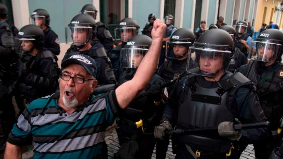 Police block demonstrators from advancing to La Fortaleza governor's residence in San Juan, Puerto Rico on Sunday.