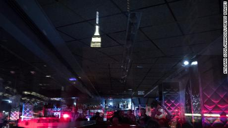 People wait in a Manhattan diner during a massive power outage that hit parts of New York City on July 13, 2019.