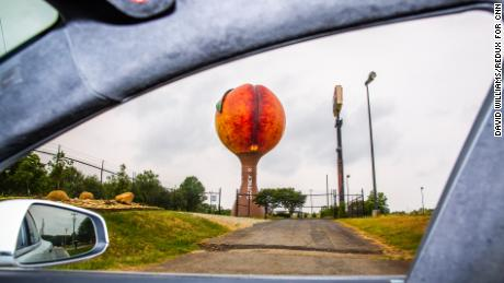 Peachoid, a 135-foot tall tower in Gaffney, South Carolina, painted to resemble a peach, is seen through the Tesla window.