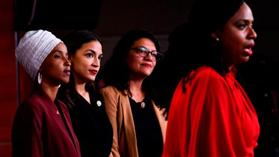 """US Representatives Ayanna Pressley (D-MA) speaks as, Ilhan Abdullahi Omar (D-MN)(L), Rashida Tlaib (D-MI) (2R), and Alexandria Ocasio-Cortez (D-NY) hold a press conference, to address remarks made by US President Donald Trump earlier in the day, at the US Capitol in Washington, DC on July 15, 2019. - President Donald Trump stepped up his attacks on four progressive Democratic congresswomen, saying if they're not happy in the United States """"they can leave."""" (Photo by Brendan Smialowski / AFP)        (Photo credit should read BRENDAN SMIALOWSKI/AFP/Getty Images)"""