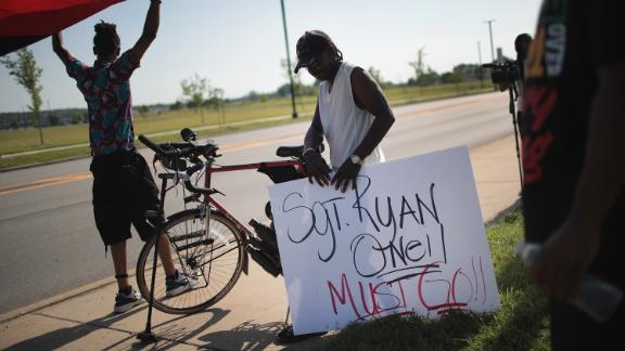 Demonstrators protest the shooting death of Eric Logan outside of the South Bend Police Station after his funeral on June 29.