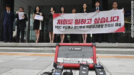 South Korean news presenters of the local TV network Munhwa Broadcasting Corporation hold a rally before submitting a complaint on workplace harassment to the employment and labor office in Seoul on July 16, 2019.