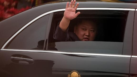 Kim Jong Un waves from his car upon his arrival in Vietnam on February 26 to attend the second US-North Korea summit.