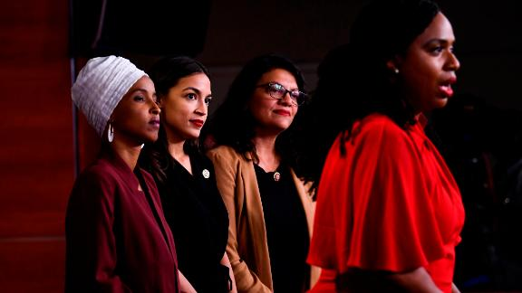 "US Representatives Ayanna Pressley (D-MA) speaks as, Ilhan Abdullahi Omar (D-MN)(L), Rashida Tlaib (D-MI) (2R), and Alexandria Ocasio-Cortez (D-NY) hold a press conference, to address remarks made by US President Donald Trump earlier in the day, at the US Capitol in Washington, DC on July 15, 2019. - President Donald Trump stepped up his attacks on four progressive Democratic congresswomen, saying if they're not happy in the United States ""they can leave."" (Photo by Brendan Smialowski / AFP)        (Photo credit should read BRENDAN SMIALOWSKI/AFP/Getty Images)"
