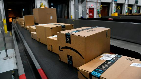 THORNTON, CO - FEBRUARY 19: Boxes move along on conveyor belts towards awaiting truck to be shipped out at Amazon's Fulfillment Center on March 19, 2019 in Thornton, Colorado. The facility which opened in July of 2018 is 855,000 square feet, and employees over 1500 people. The Thornton facility is a state-of-the-art facility that uses Amazon Robotics to move the merchandise around from one area to the next.  Hundreds of workers perform a variety of jobs in the huge facility. Many workers stand at stations, picking items to ship from trays brought to them by robots that roam the massive warehouse floor. The robotic facility, near I-25 and 144th Avenue, distributes small- and medium-sized items and  allows for quicker delivery of orders in the metro area.  (Photo by Helen H. Richardson/MediaNews Group/The Denver Post via Getty Images)