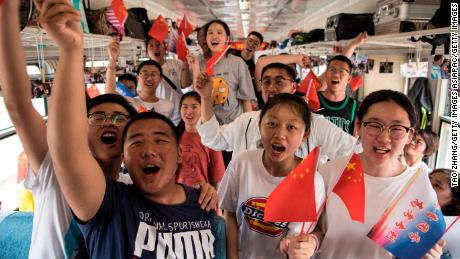 "Students board a ""gaokao train"" at Dayangshu township on June 5 in the Inner Mongolia Autonomous Region, China."