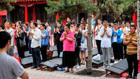Parents pray for high marks for their children who take the National College Entrance Examination (aka Gaokao) at Ci'en temple on June 7, 2018 in Shenyang.