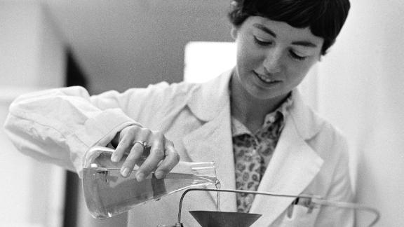 One of the experiments at Ames in 1969 included biologist Caye Johnson preparing a vitamin mixture for Petri dishes with lunar samples.