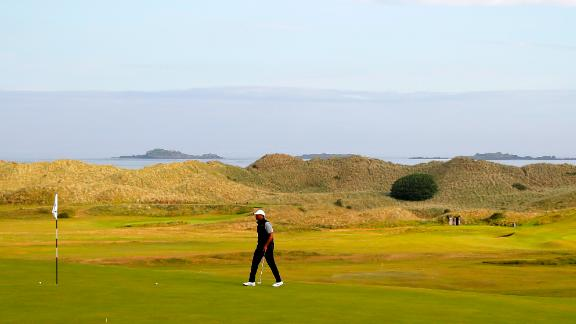 Tiger Woods walks onto a green during practice for The Open at Royal Portrush.