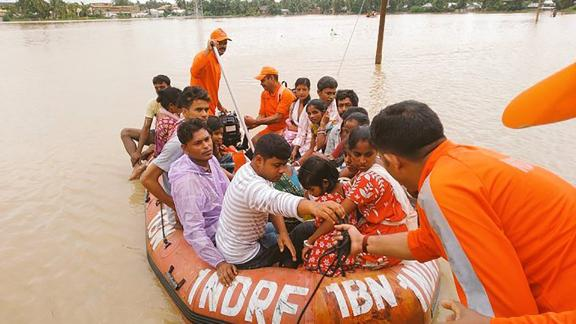 Indian officials carry out evacuations in flooded Golghat, in India