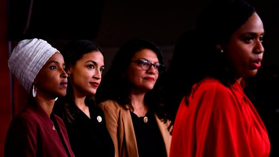Rep. Ayanna Pressley speaks as her colleagues listen - from left, Rep Ilhan Omar, Rep. Alexandria Ocasio-Cortez and Rep. Rashida Tlaib.