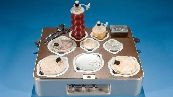 The Skylab food tray with individual heated canned food compartments.